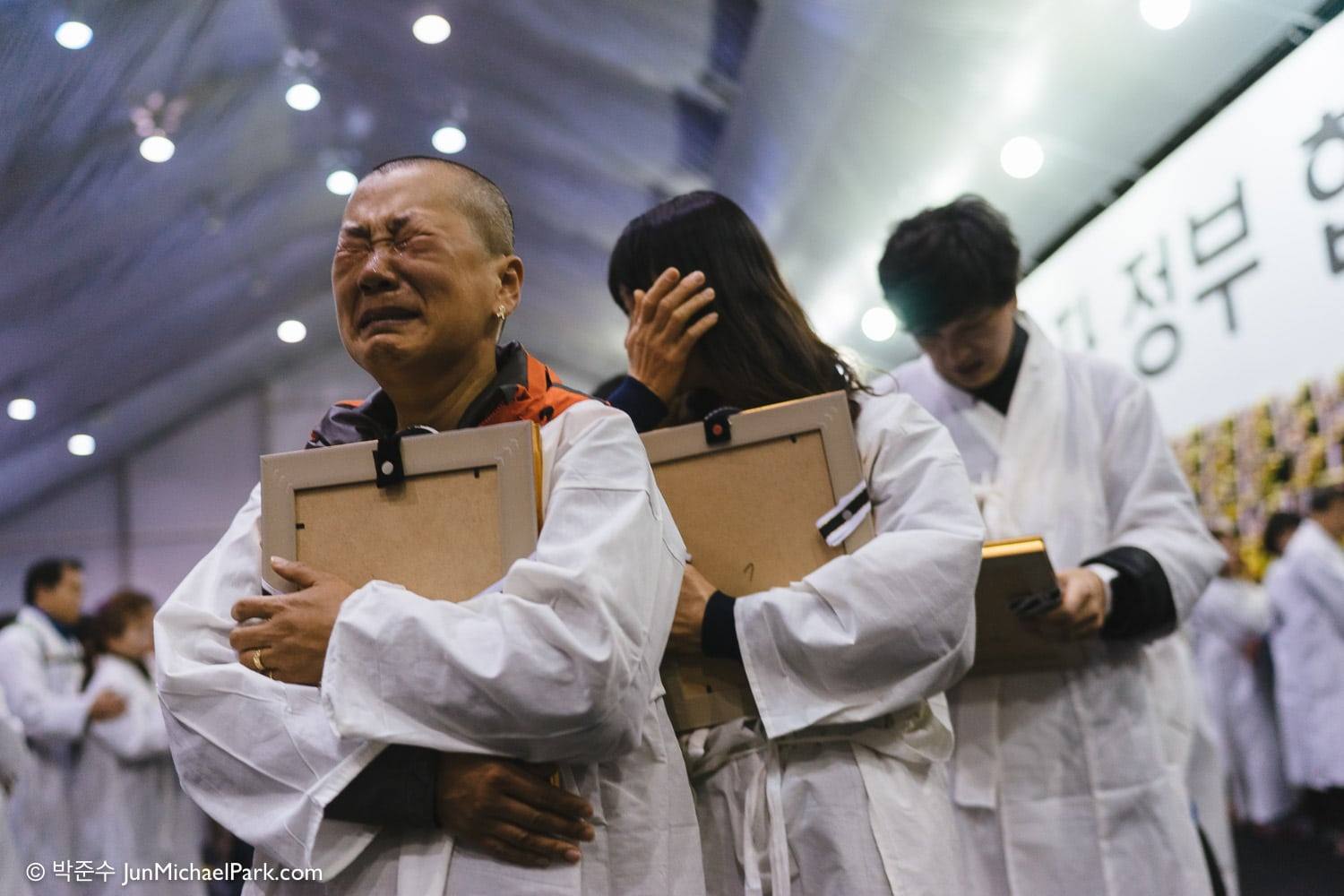Parents of the Sewol ferry student victims take down their children's funerary portraits from the official altar and stage a two-day marching protest from Ansan to Seoul to generate support for the independent inquiry into the government's handling of the disaster. April, 2015