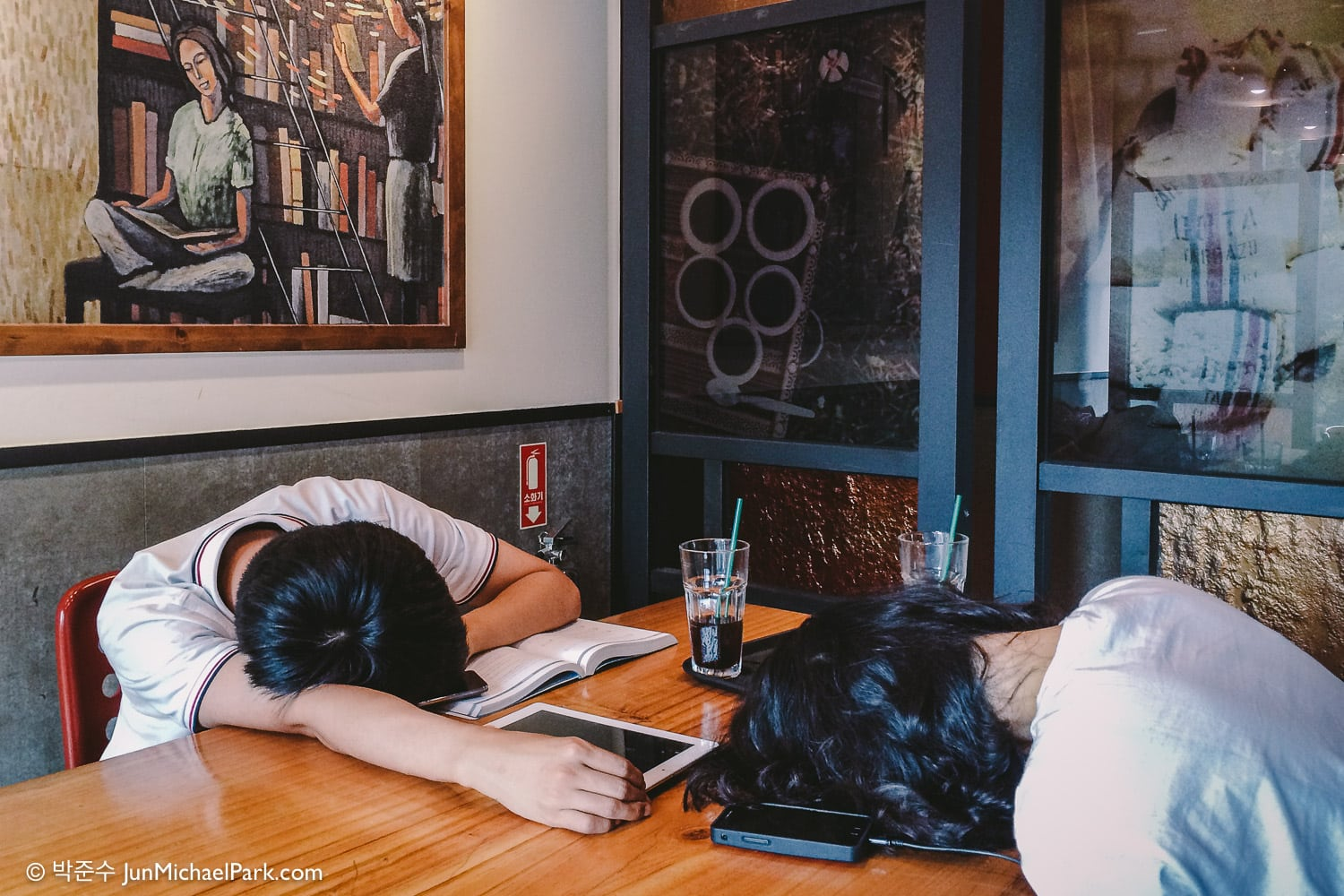 A college student couple takes a study break at a Starbucks in Seoul, South Korea. It's common to spot students sleeping in local cafes. June 2015.