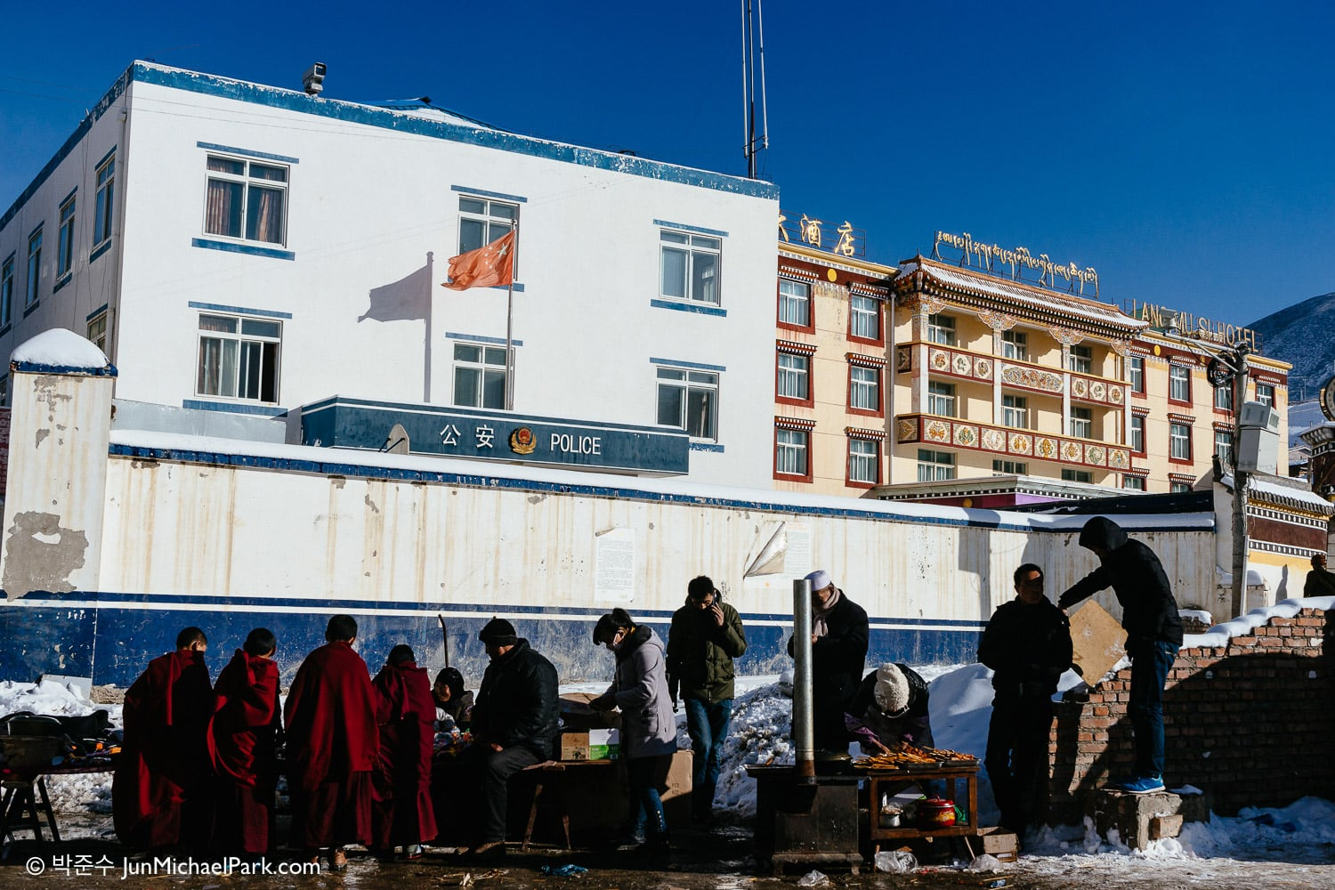 Feb, 2014 - Tibetan child monks gather at a vendor in front of a Gongan office in Langmusi, Gannan, Gansu Province, China.