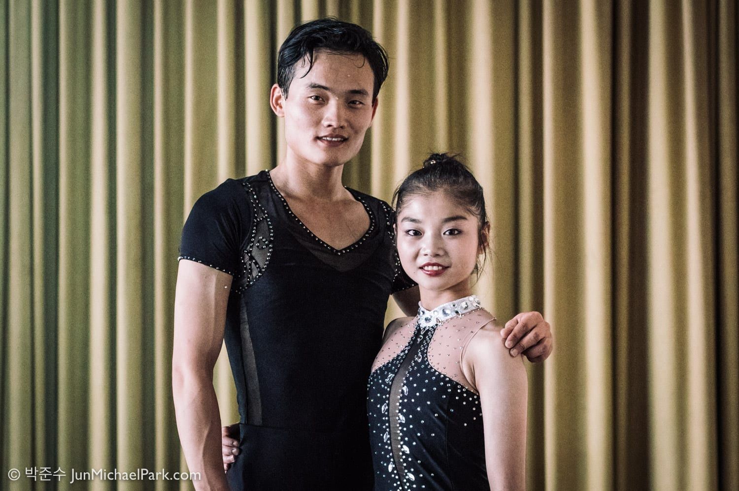 After their long program, North Korean skaters Ryom Tae-ok, right, and Kim Ju-sik pose for a portrait after an interview in the mixed zone in the Eissportzentrum, Oberstdorf, Germany. For The New York Times. 29 Sep 2017.