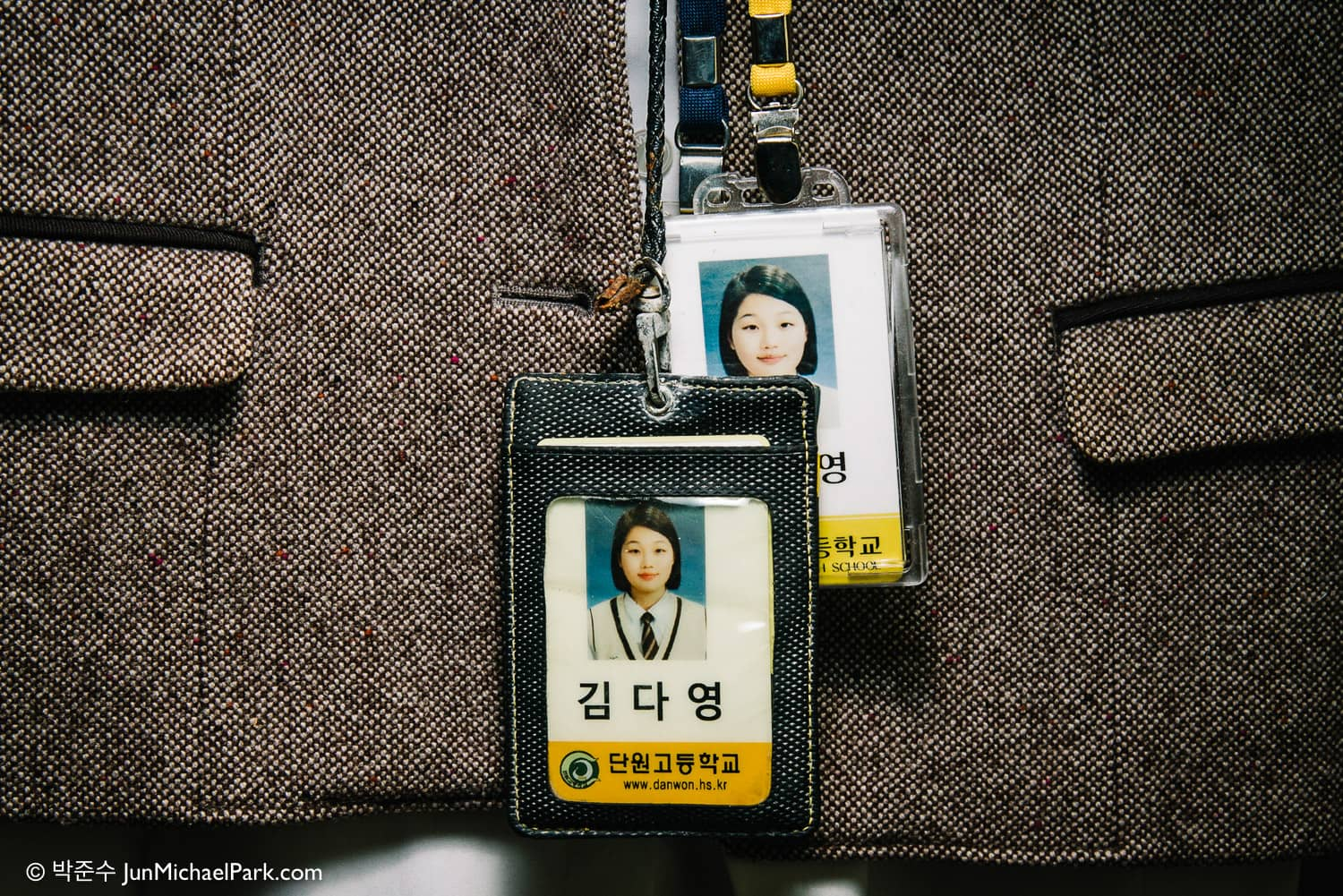 Da-young's original student ID on the front was retrieved from the sunken ferry along with her other belongings. Sea water has corroded the metal chain. It alludes to a slow and painful death by drowning.