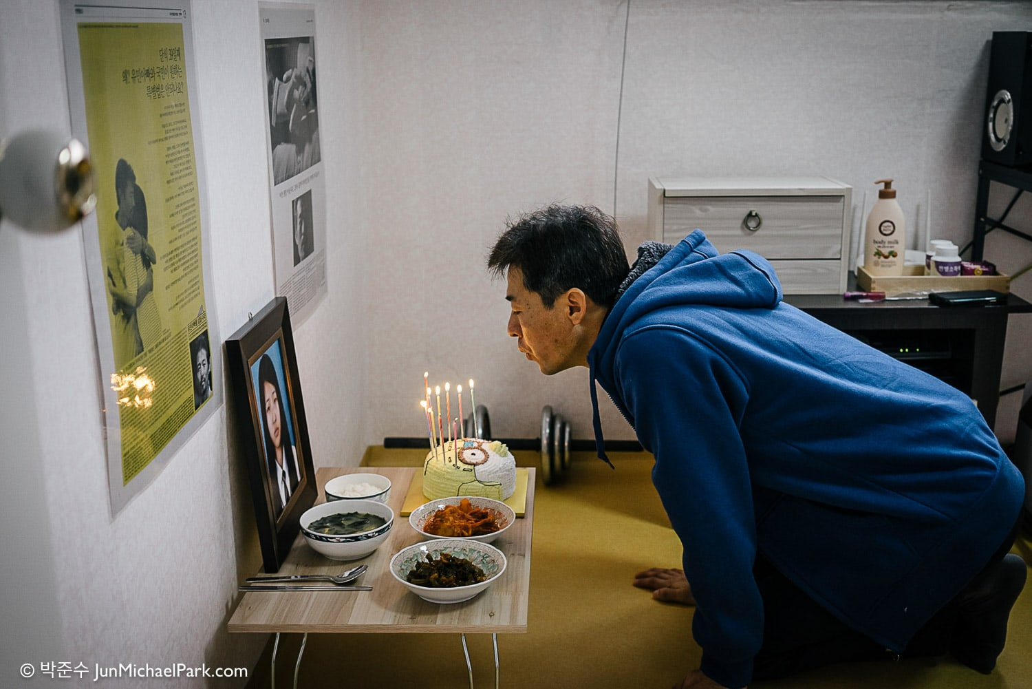 """Happy birthday, my princess."" Kim blows out birthday candles on Yu-min's birthday. Had she been alive, Yu-min would have turned 18 on Jan 14."