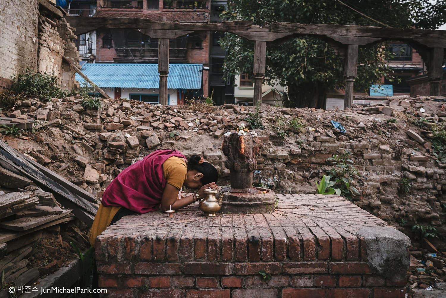 Early morning, a female resident prays in ruins at Kathmandu Durbar Square, Nepal. 02.11.15