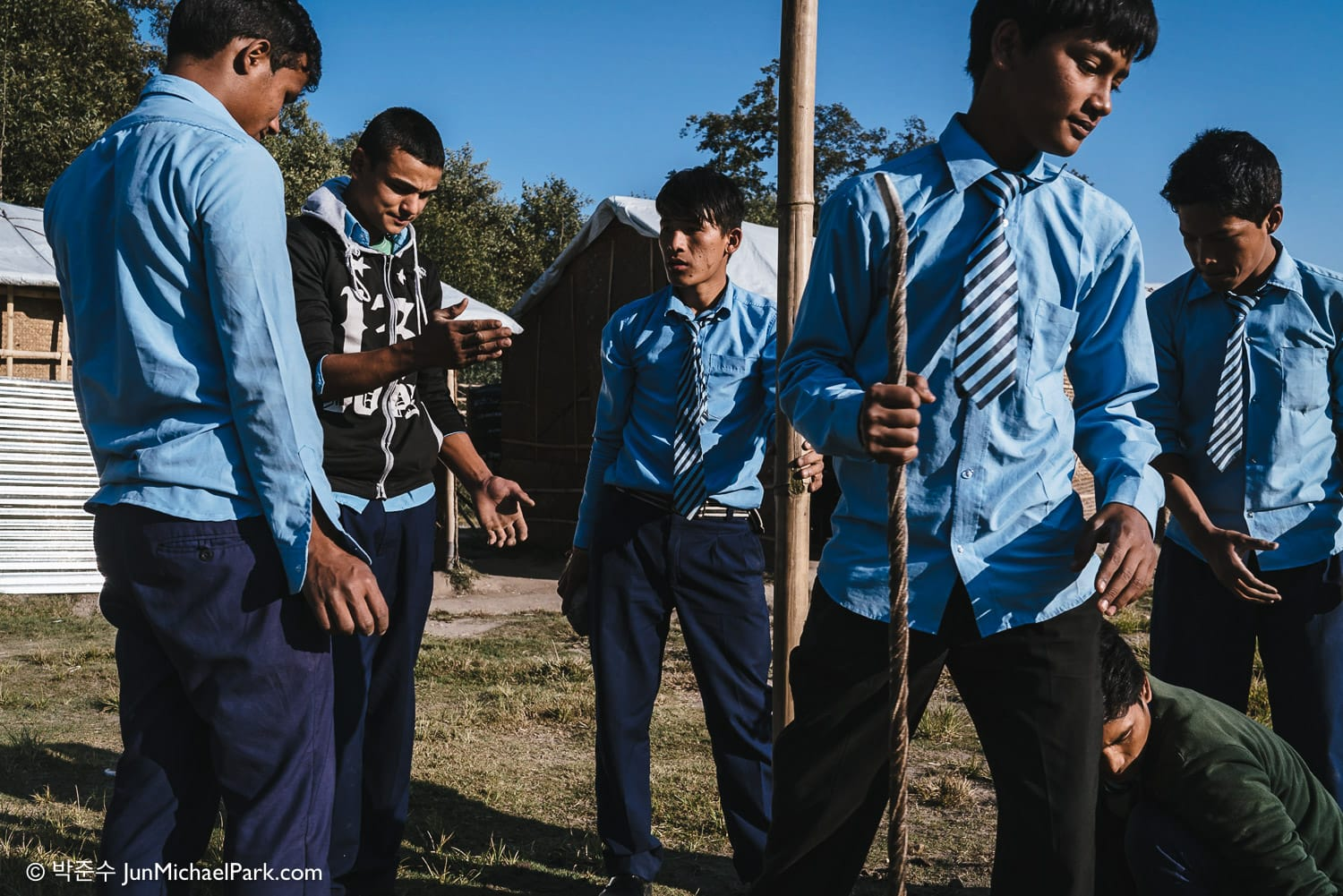 Students at Kavresthali Secondary School north of Kathmandu plant a pole in the playground. The school was completely destroyed by the earthquake. UNICEF came to rescue and built temporary classrooms. 03.11.15