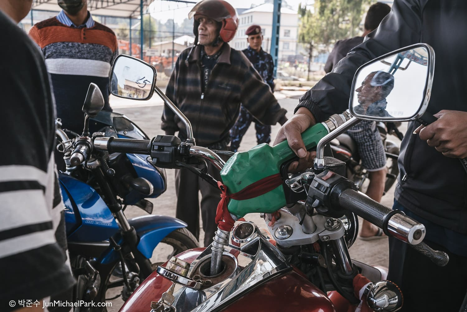 After 3 days of waiting, motorists refuel at Mahalaxmi Fuel Station, Kathmandu, Nepal, one of many state-run petrol stations. Due to the fuel shortage, petrol prices in the black market have spiked five times the normal price. 05.11.15