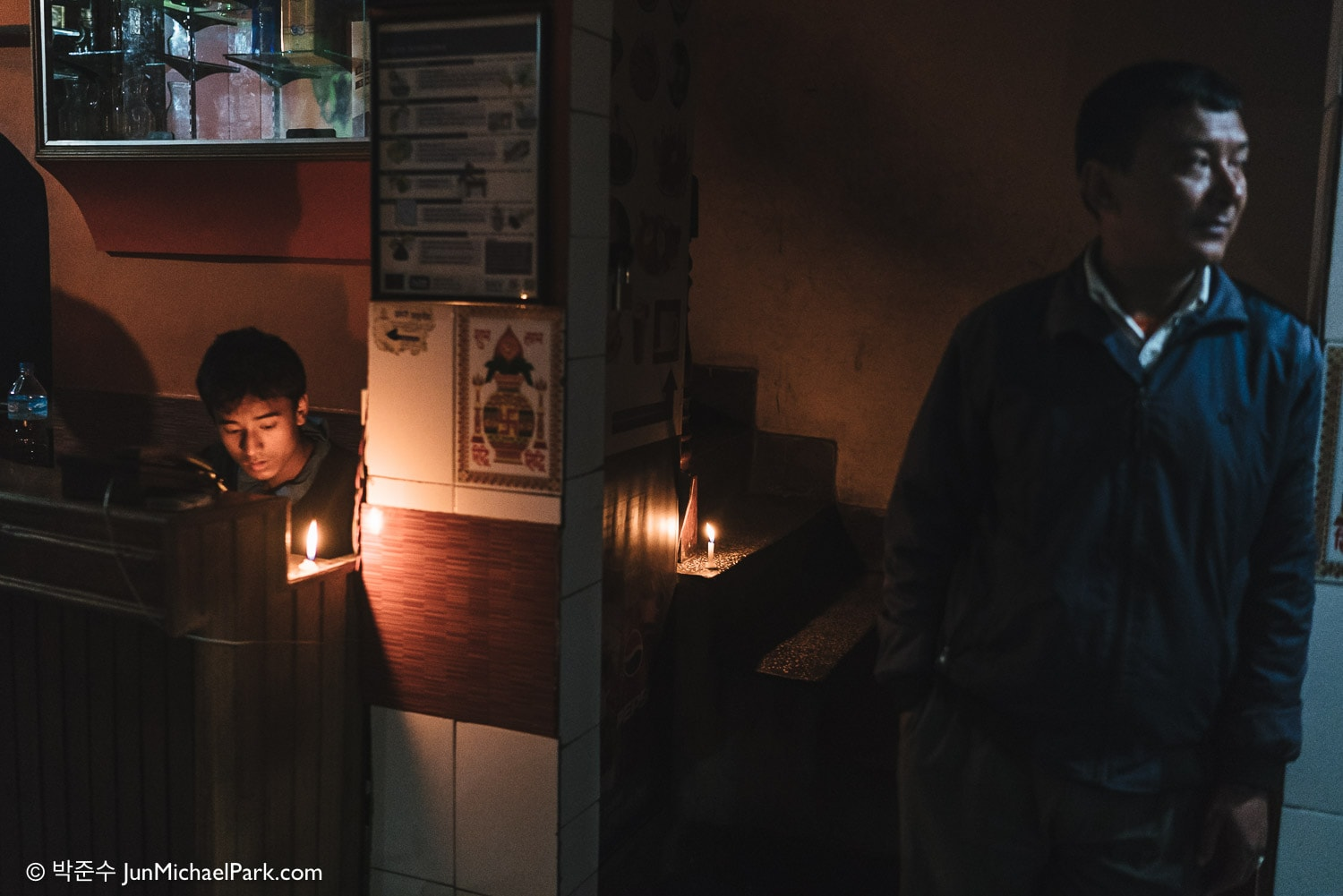 Candles are lit in a restaurant at Thamel district, Kathmandu, Nepal. Power outages are frequent due to the fuel shortage, and solar generators barely power dim fluorescent lights. 02.11.15